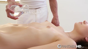 Couple combines massage with passionate affair