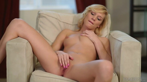 Beautiful blonde gently touches clit with sex toy