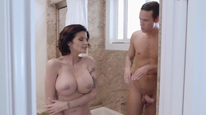 Busty mommy with short hair takes a long dick in the bathroom