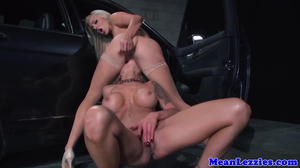 Two MILFs fucking like crazy in a parking lot