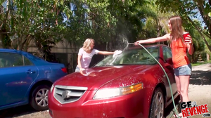 Two kinky whores are washing a car before a threesome